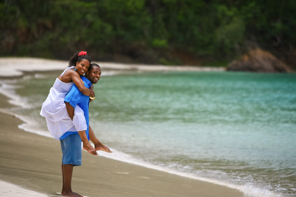 St.Thomas USVI Engagement Hull Bay Beach portraits session on Hull beach giving a piggy back ride.