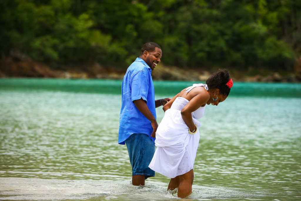 St.Thomas USVI Engagement Hull Bay Beach portraits session on Hull beach in the bay looking at fish.