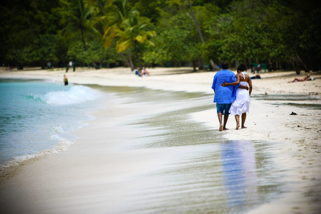 St.Thomas USVI Engagement Hull Bay Beach portraits session on Hull beach walking down the beach with arms around each other.