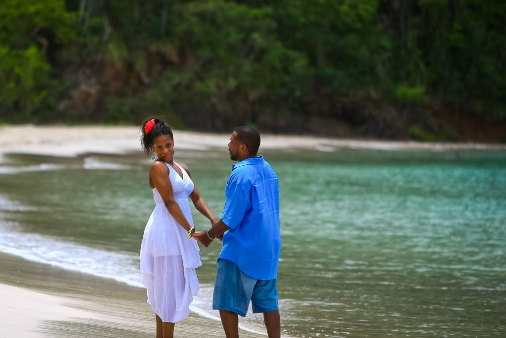 St.Thomas USVI Engagement Hull Bay Beach portraits session on Hull beach holding hands.