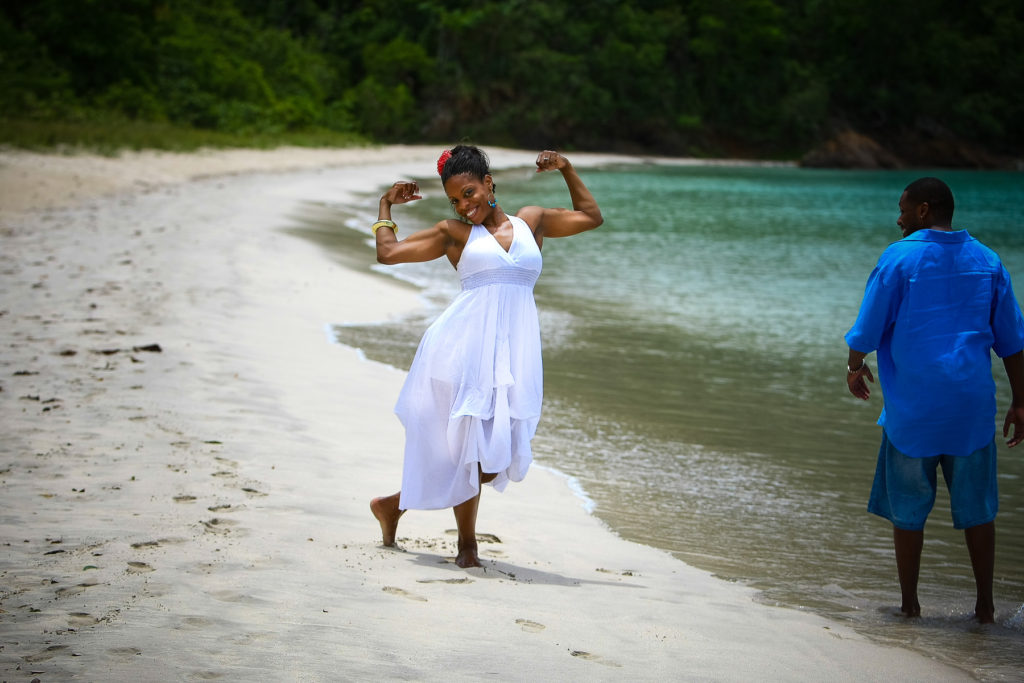 St.Thomas USVI Engagement Hull Bay Beach portraits session on Hull beach showing off muscles.