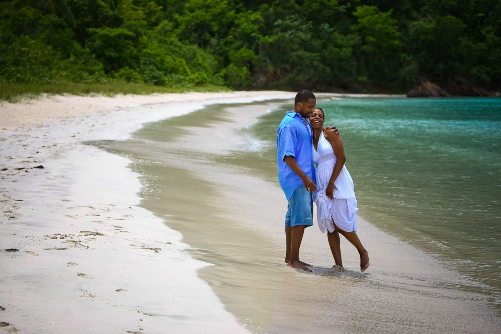 St.Thomas USVI Engagement Hull Bay Beach portraits session on Hull beach leaning on shoulders.